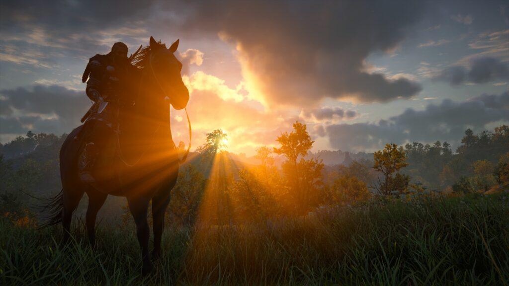 Ein Mann reitet mit einem Pferd in den Sonnenuntergang