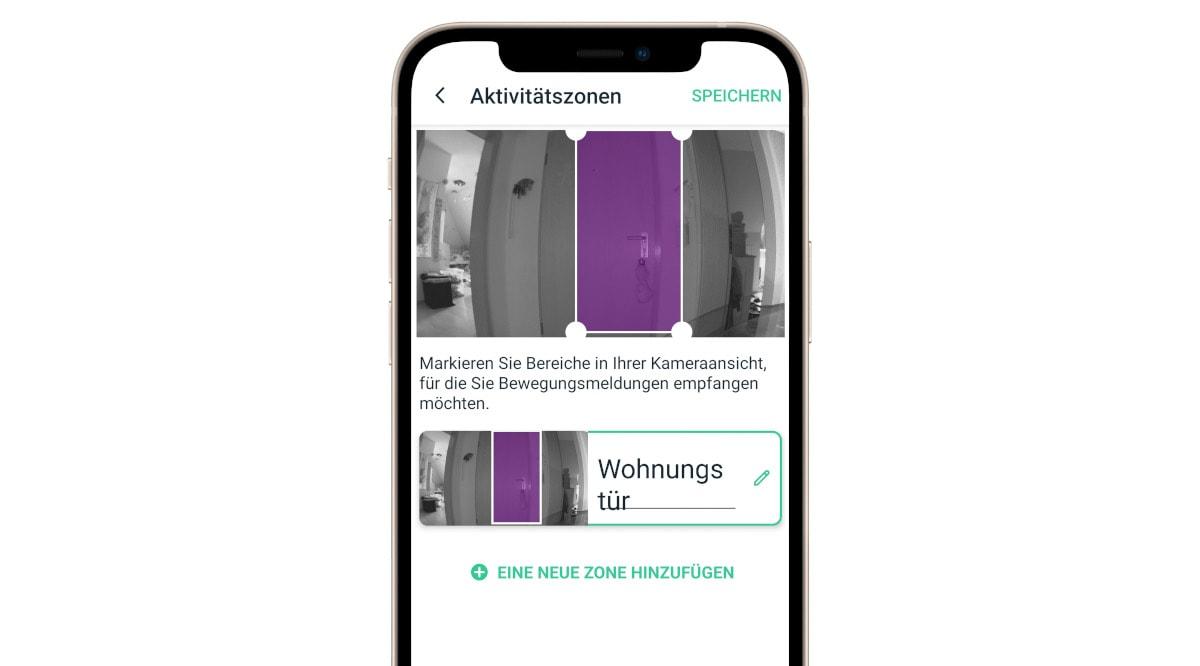 Handy zeigt App zum Einstellen des Bereichs den eine Videokamera überwachen soll auf weißem Hintergrund
