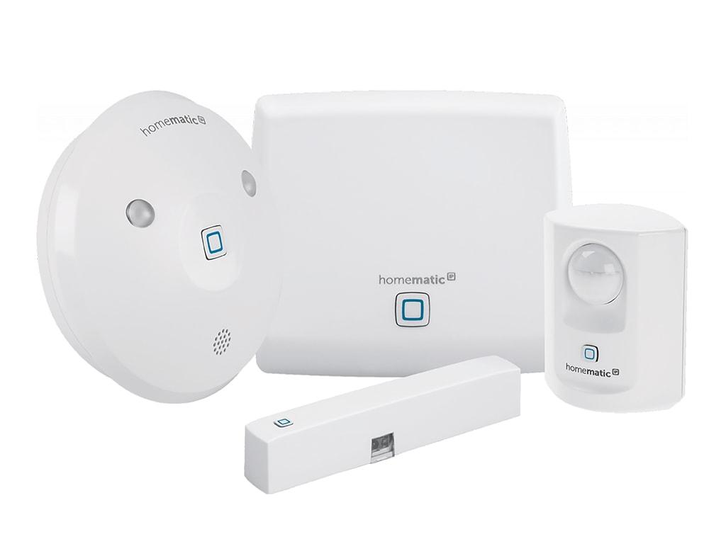 Vier Weiße runde und eckige Homematic Geräte in unterschiedlichen Größen vor weißem Hintergrund