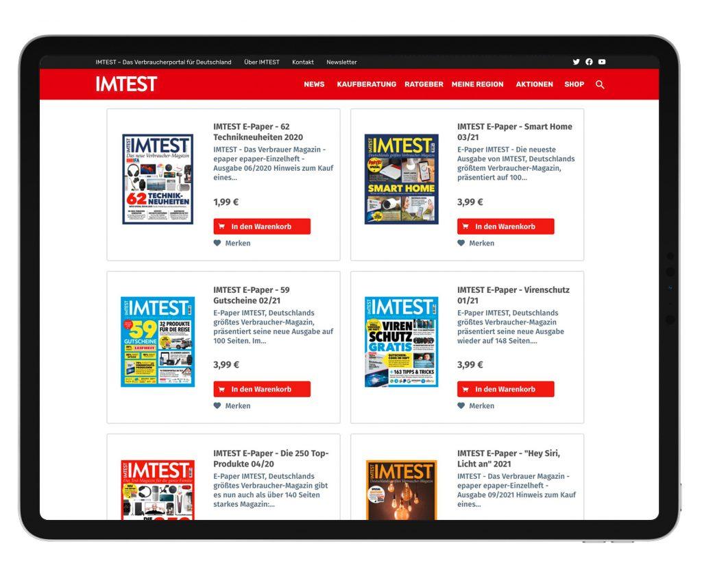 Tablet zeigt IMTEST-Shop, auf weißem Hintergrund
